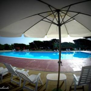 Book Now Camping Village S'Ena Arrubia (Arborea, Italy). Rooms Available for all budgets. Located in Arborea Camping Village S'Ena Arrubia has an outdoor summer pool and a Sardinian restaurant. It offers free WiFi in public areas and self-catering accommodation wit