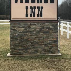 Hotels near Infinity Downs Farm - Village Inn