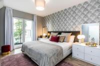 Gloria Design Suites - Apartments & Rooms