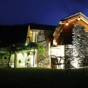 Book Now Affittacamere Grand Saint Bernard (Gignod, Italy). Rooms Available for all budgets. Offering views of Mount Grand Combin Affittacamere Grand Saint Bernard is surrounded by peaceful gardens. It offers free Wi-Fi and Alpine rooms with a balcony and private bath