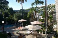 Grand Palm Plaza (Gay Male Clothing Optional Resort) A North Beach Village Resort Hotel Image