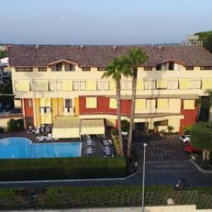 Book Now Hotel Agora (Lago Patria, Italy). Rooms Available for all budgets. Hotel Agora' offers accommodation 2 km from Lago Patria. The hotel has a fitness centre and water sports facilities and guests can enjoy a meal at the restaurant or a drink at