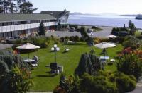 The Cedarwood Inn & Suites Image